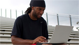 Larry Fitzgerald at computer